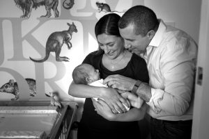Mum and dad are besotted with their newborn baby during this family photographer London session.