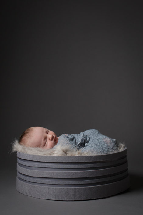 A baby sleeps beautifully during his baby photographer North London photoshoot