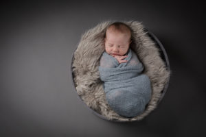 A birds eye view image of a newborn baby during his baby photographer London session