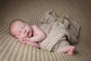 A baby rests during his baby photographer Muswell Hill session