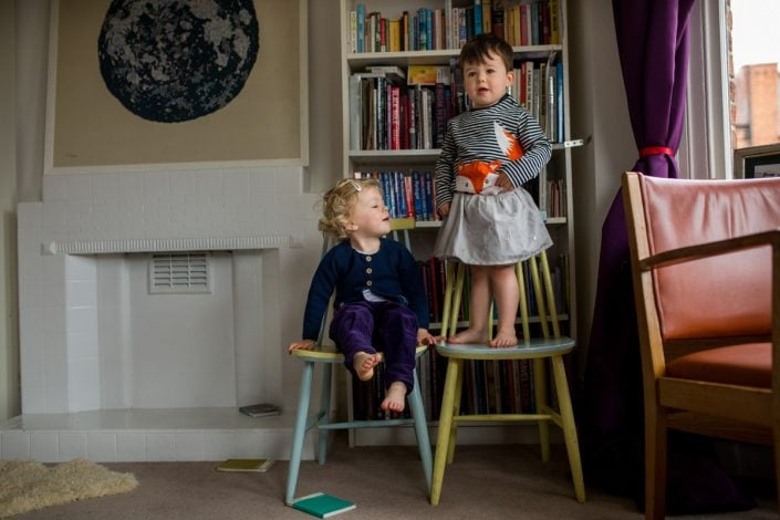 Twins dress up during an at home family photoshoot North London