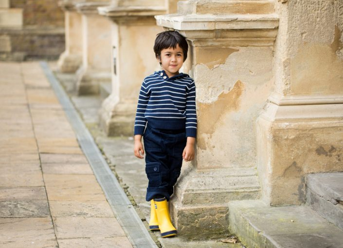 A boy poses naturally during a family photographer North London session