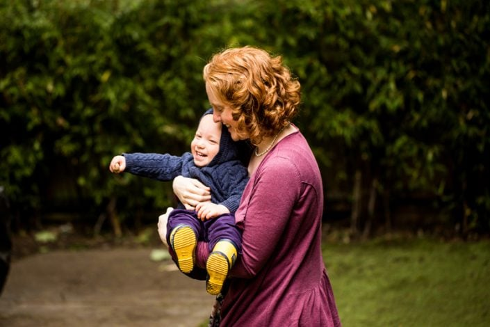 A mum has fun with her baby boy during a family photoshoot North London