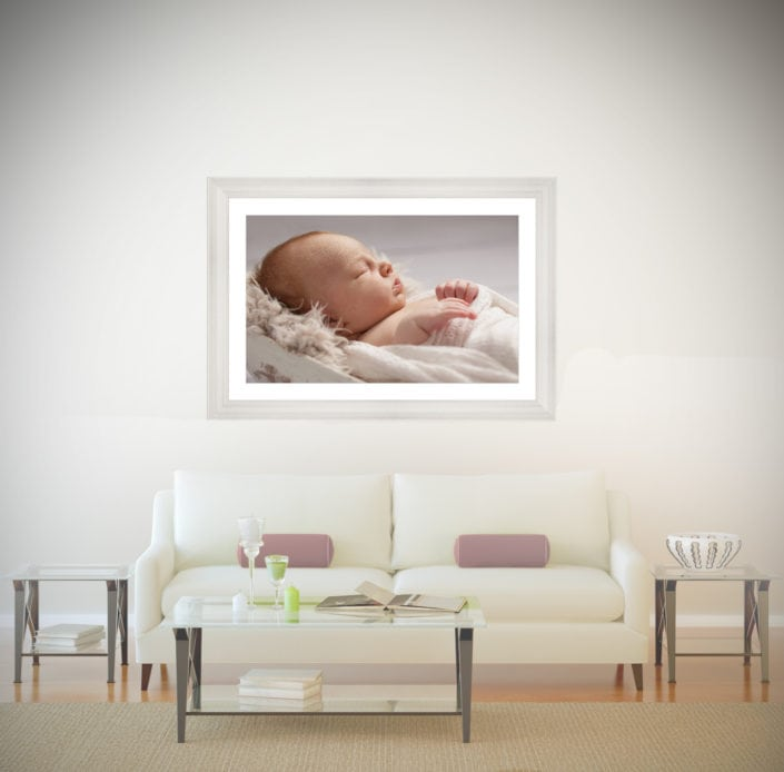This living room looks incredible with a statement wall art piece of a newborn baby