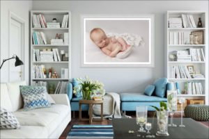 A huge Baby wall art hangs on the living room wall above a comfy sofa