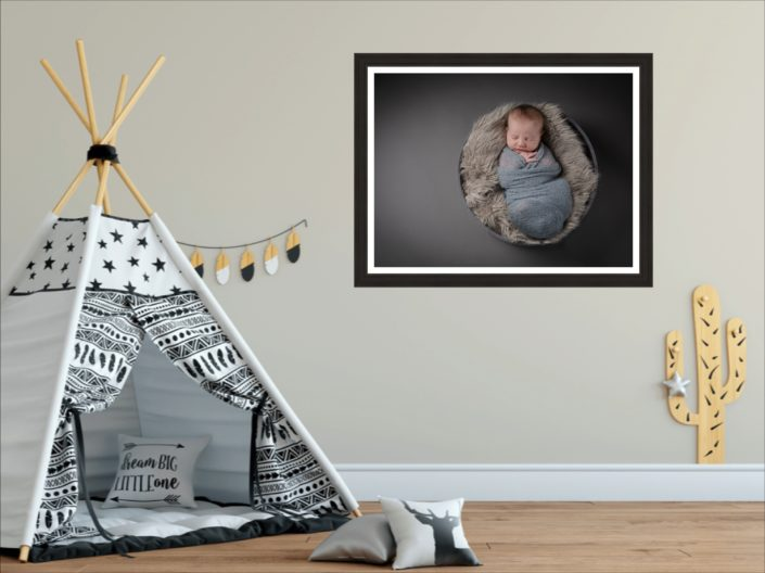 One statement wall art hangs next to a children's teepee play tent