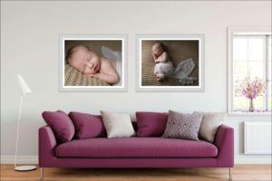 A living room is dressed with two large newborn wall arts.