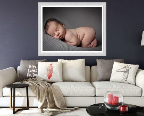 A statement wall art from Louisa Peacock Photography hangs in a trendy living room