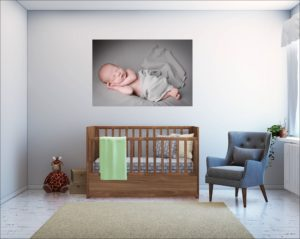 A baby's nursery is the perfect place to hang a newborn gallery following your baby photographer London photoshoot