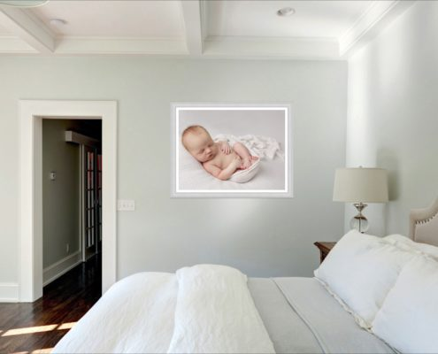 A wall art hangs in the bedroom after a Muswell Hill baby photographer shoot
