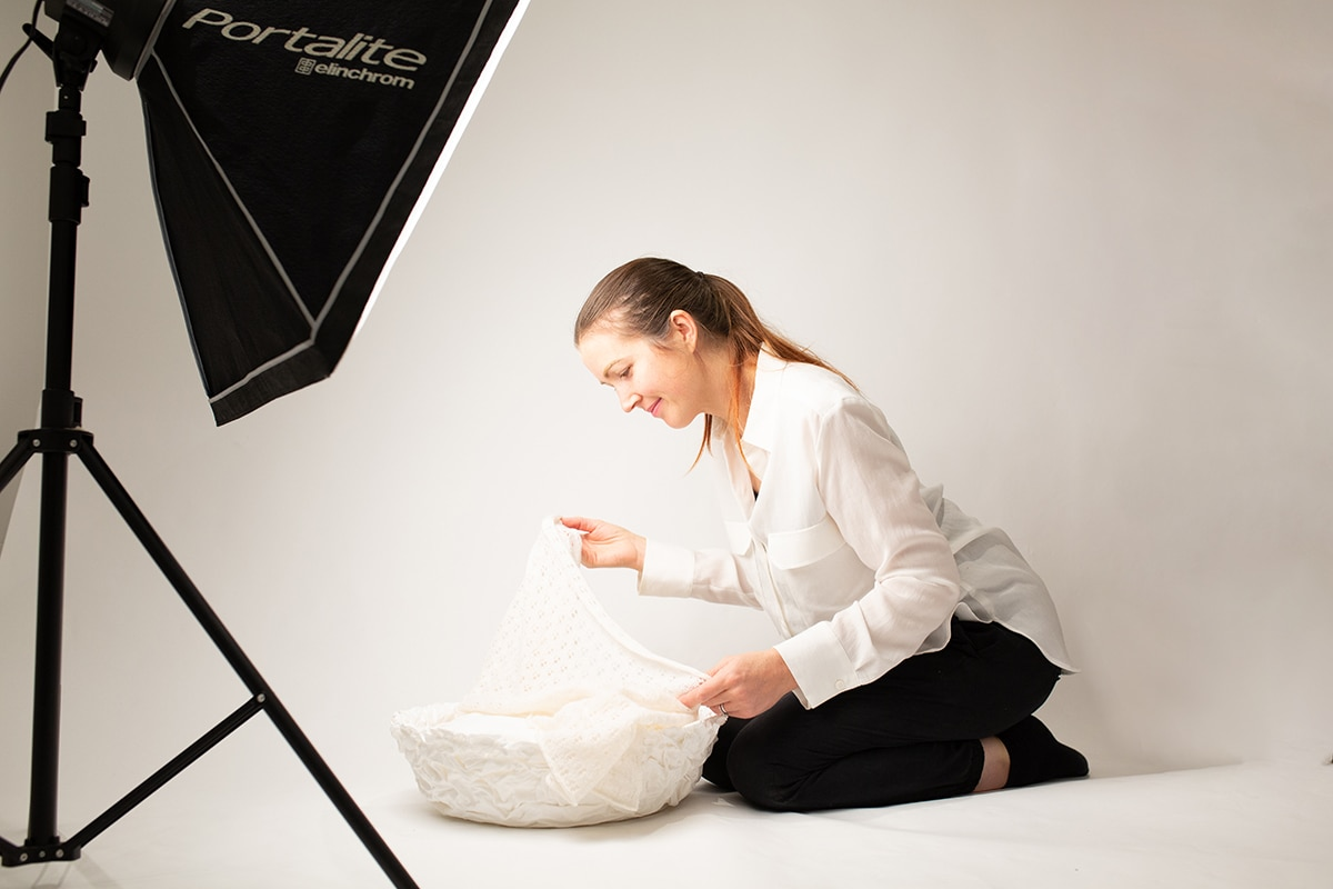 Baby photographer London: Louisa Peacock prepares the studio for a newborn photography session