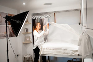 Louisa prepares her studio for a north London photography session