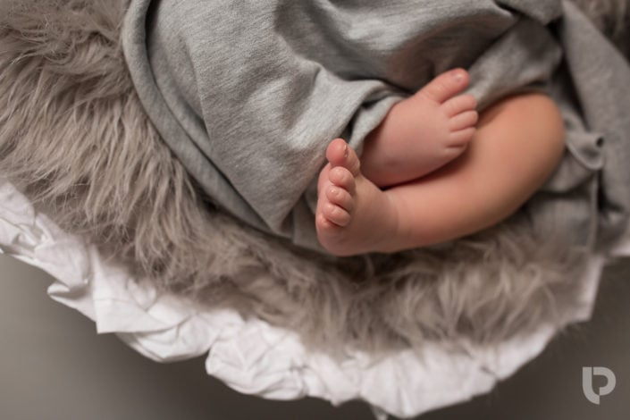 A close of Baby's feet during a Muswell Hill photography baby shoot