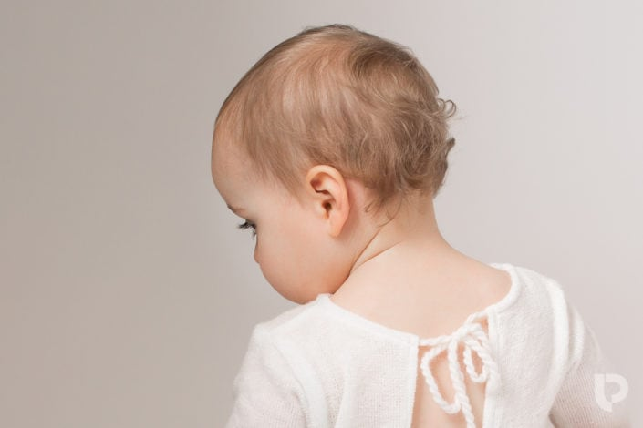 Great baby photographers London will always capture details of the baby's hair, eyelashes, curls and so on