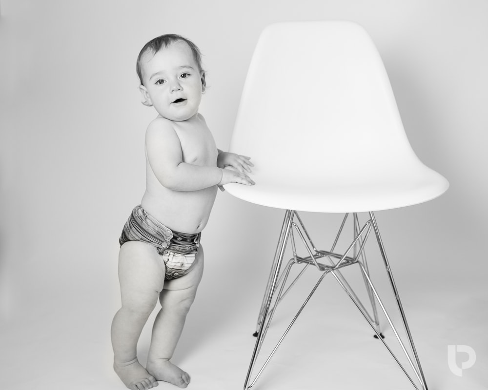 This baby is just starting to stand up during her Muswell Hill baby photographer session