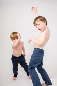 Two brothers mess about during their Muswell Hill photographer photoshoot