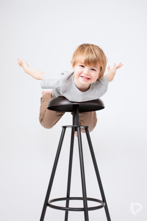 A three year old flies on the stall during his Muswell Hill photographer session