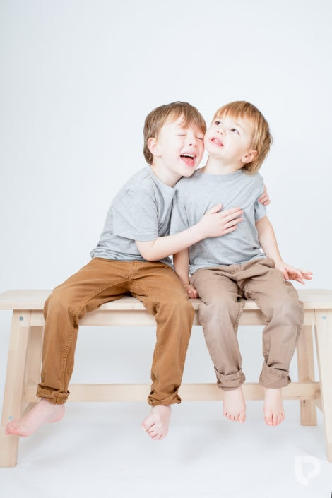 Sibling love: Two boys hug each other during their North London photographer session
