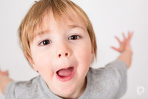 A three year old messes about during his Muswell Hill photographer session