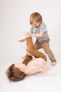 A little play fighting is encouraged at Louisa Peacock Photography