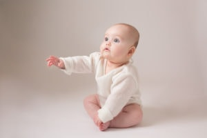 A baby sits up during her North London photoshoot