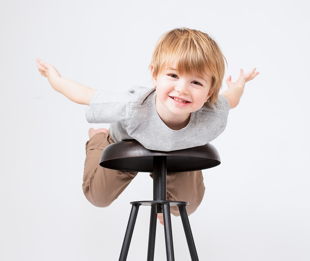 A preschooler has fun during his Muswell Hill photographer session