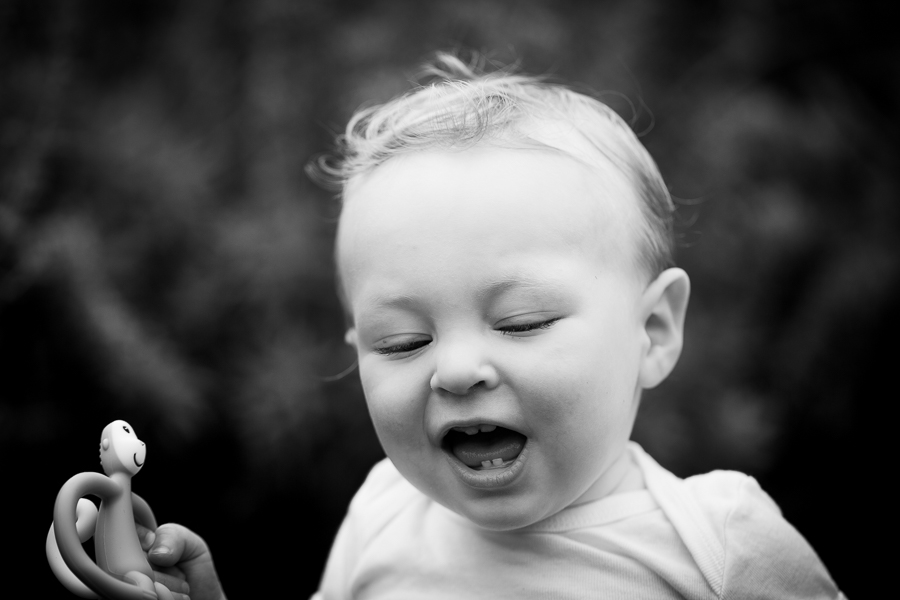 This little boy relaxes and enjoys time with one of the best family photographers in London