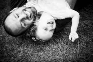 Best family photographers capture genuine heartfelt moments, like this dad and daughter laughing
